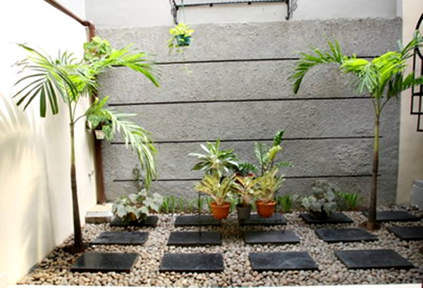 Taman rumah minimalis dengan dinding batu alam 3